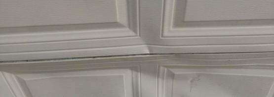 bent garage door panel repair